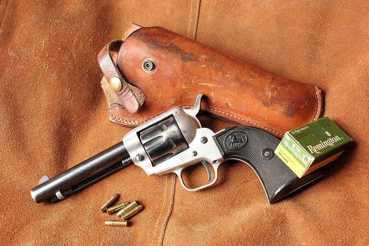 John still has the firearm purchased during his first visit to a gun store, his father's Colt Frontier Scout.